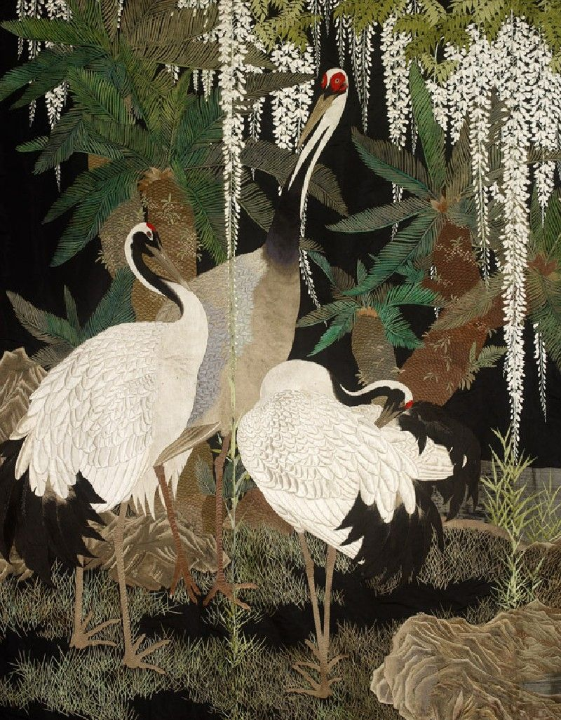 Cranes, cycads, and wisteria. Japan, c. 1905. Obverse: shioze (ribbed silk), dyed black, and embroidered with coloured silk, flat silk, and paper-backed gold foil wrapped around a silk or cotton core; brown silk brocade border reverse: cotton, with freehand paste-resist decoration (tsutsugaki) .