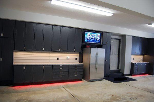 Masculine Home Garage Ideas Black Cabinet Storage Units With Fridge And Neon Lights Garage Wall Cabinets Garage Cabinets Ikea Garage Interior