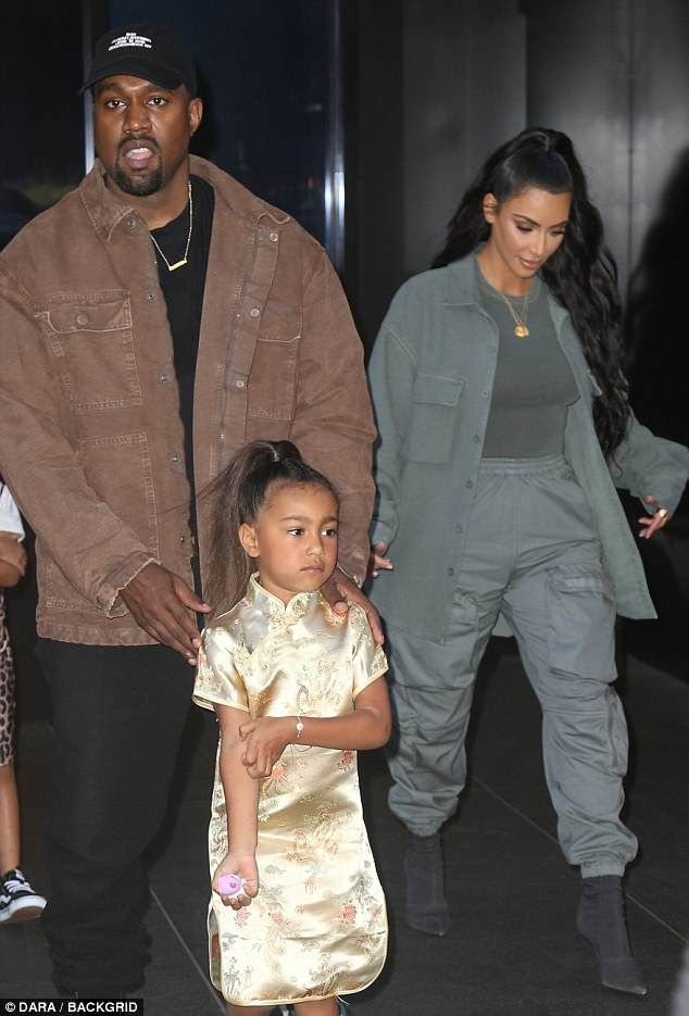 Kanye West carries unhappy looking North to her fifth ...