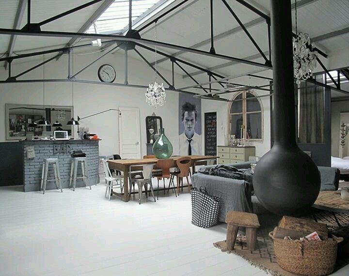 Paris loft with a shabby chic grey sofa and hanging fireplace ♥