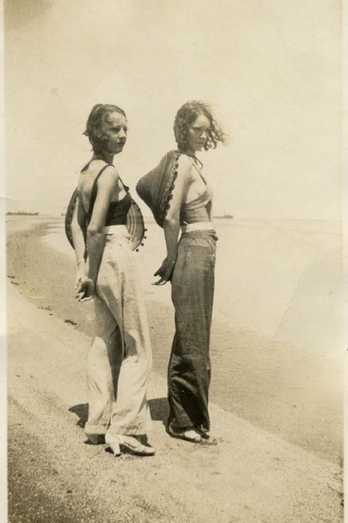 Vintage beach style. Two women on thebeach near a naval base during WWII. Image via The Sartorialist.