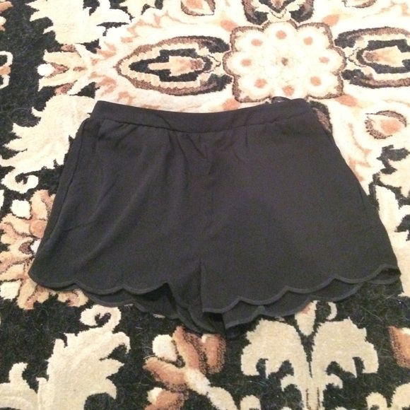 Black Scalloped Shorts Black Scalloped Shorts. Perfect condition, never been worn. Size small. Elastic only in back waistband. 100% polyester. These shorts do have pockets! Mine Shorts
