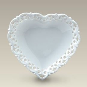 Serve a handful of delectable chocolates to your special someone on this porcelain heart shaped plate with sweet bow shaped openwork and embossing. & 5
