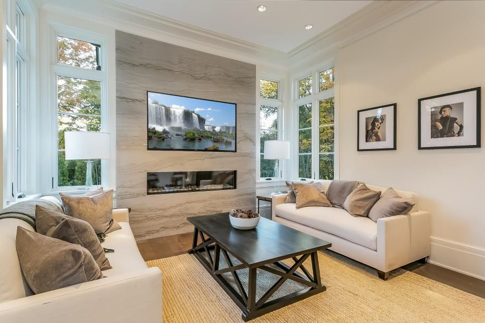 Family Lounge With Marble Accent Wall and Gas Fireplace