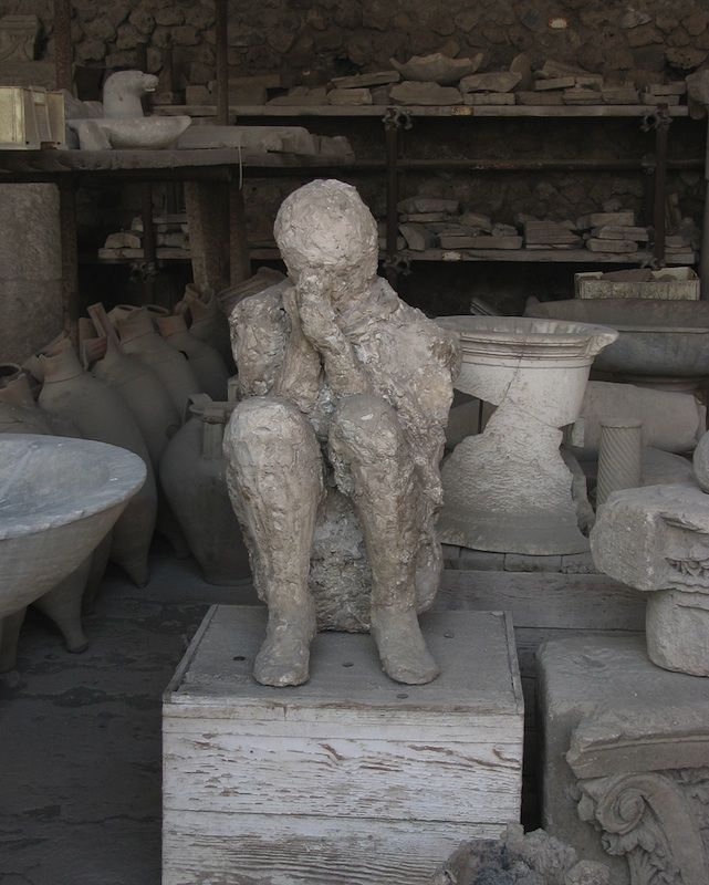 The eruption of Mt. Vesuvius buried the dead where they fell in city of Pompeii. After bodies decomposed, it left human-shaped pockets in the hardened layers of ash. Pouring plaster into these pockets creates sculptures of death...like this one.