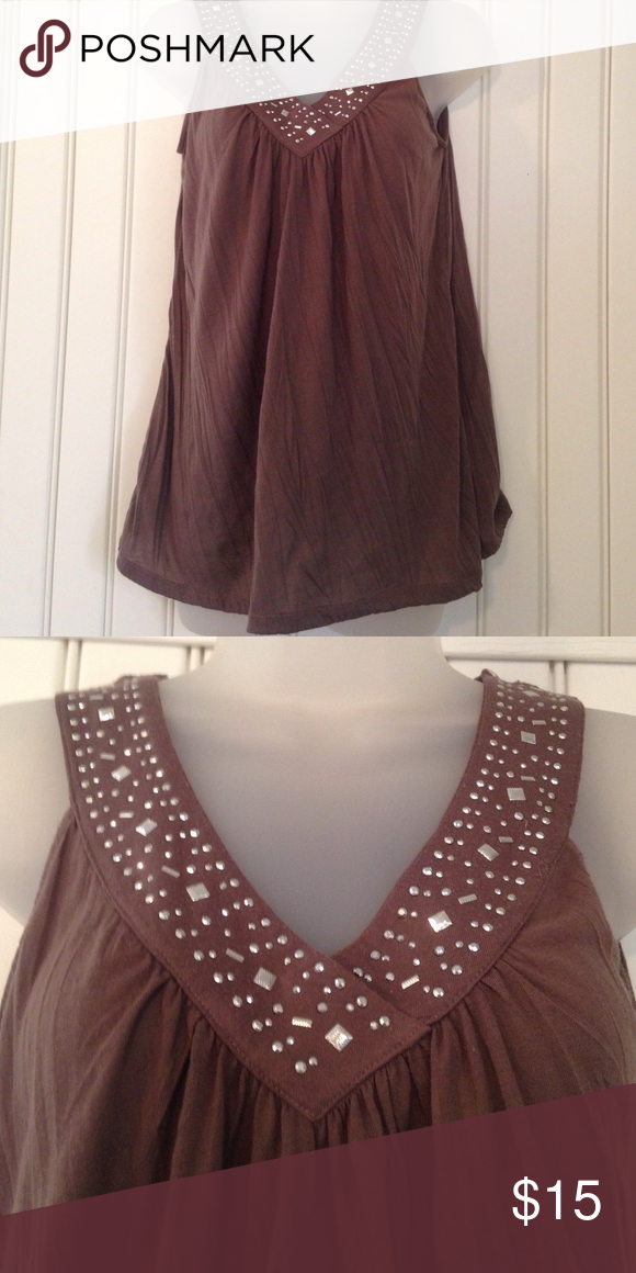 Pretty A-line Tank Top Full flowing top has nice movement and allows you to keep nice and cool. V-neck adorned with silver embellishments. I have this top in multiple colors but have never worn this one. Polyester feels like lightweight t-shirt material Allyson Whitmore Tops