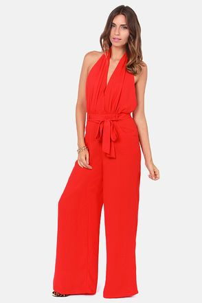 Check it out from Lulus.com! It doesn't matter whether you saunter, slide, or sprint to your computer, just make sure you don't miss the Hop Skip and Jumpsuit Backless Red Jumpsuit! Woven fabric forms a classy halter neck that buttons above an open back, before flowing into a sexy surplice bodice with a single snap closure. A belted sash flatters your waistline with the help of belt loops atop a banded waist, while wide leg pants come with convenient front pockets. Hidden back zipper/hook…