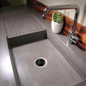concrete countertop and sink - all one piece  so attractive and