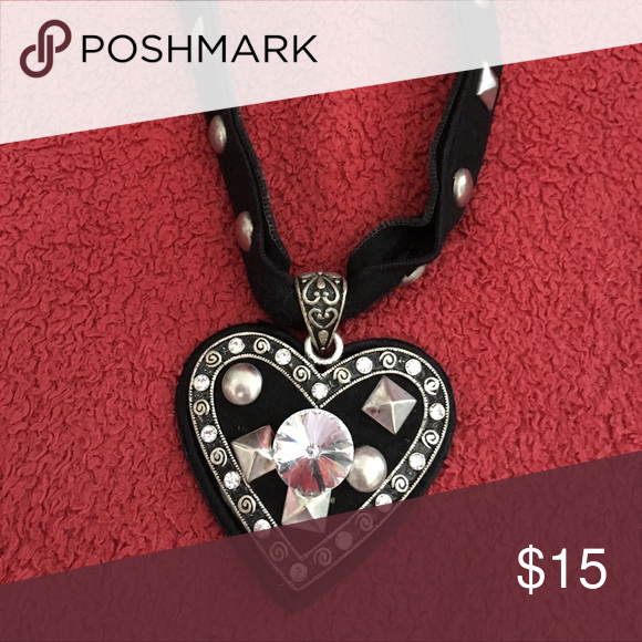 Felt heart choker Great details in this cool piece. Felt choker with grommets. Adjustable Jewelry Necklaces