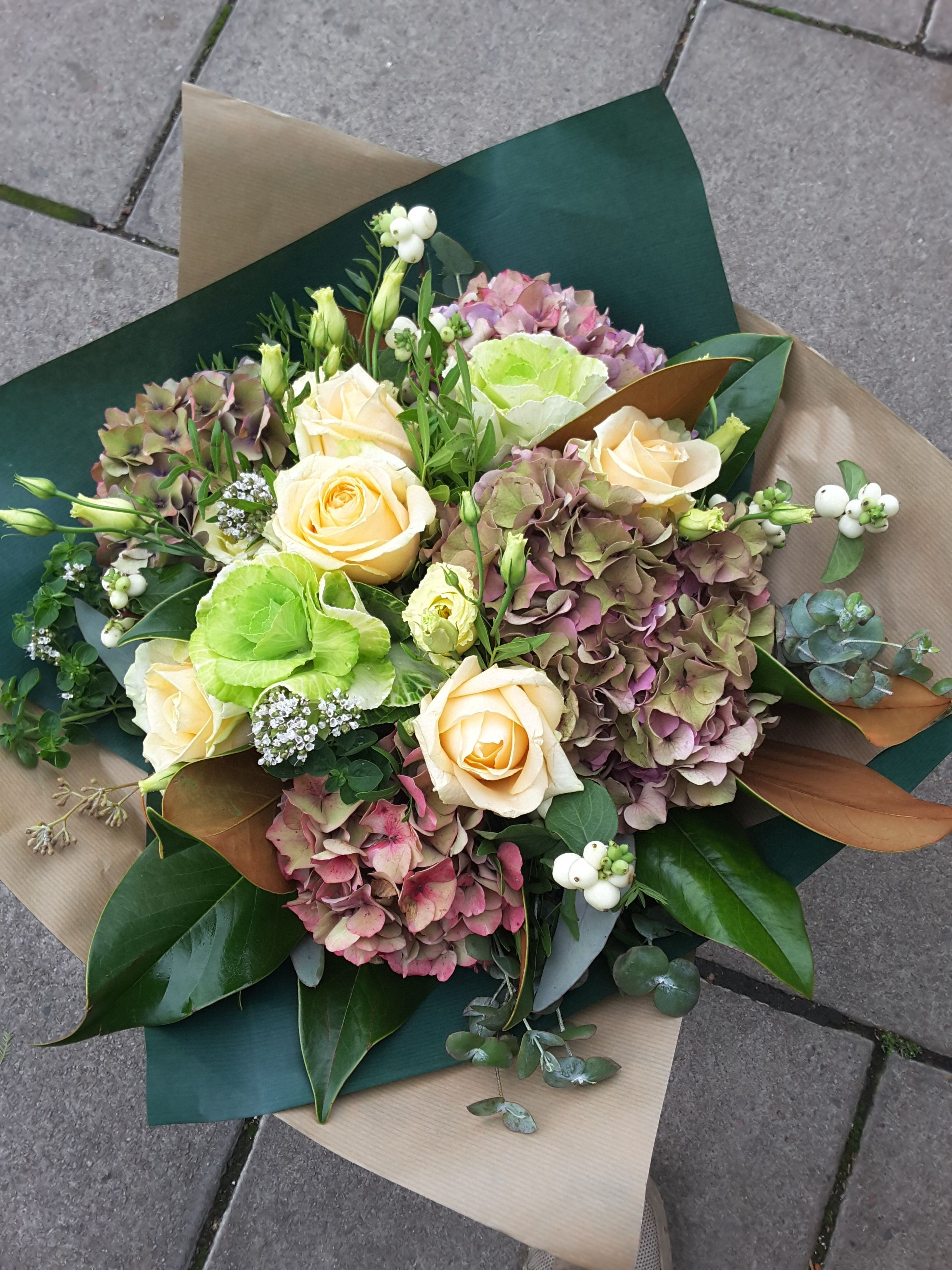 Autumnal bouquet of pale cream Roses, green Cabbages and