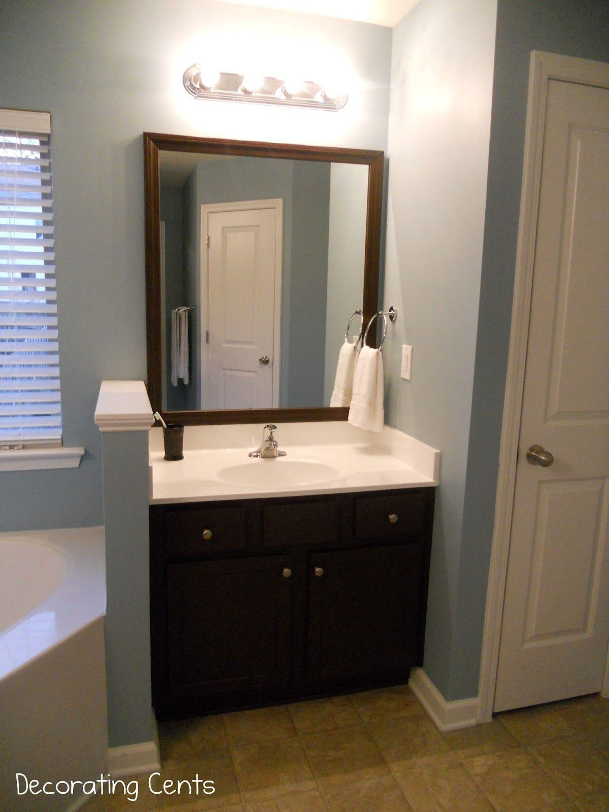 Decorating Cents Framing The Bathroom Mirrors Bathroom Mirror Bathroom Mirror Frame Cabinet Transformations