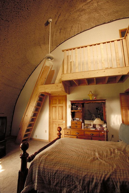 Image: Bedroom — Master bedroom has an 18-foot-high ceiling. A monk staircase leads to a L-shaped, 250-square-foot study.
