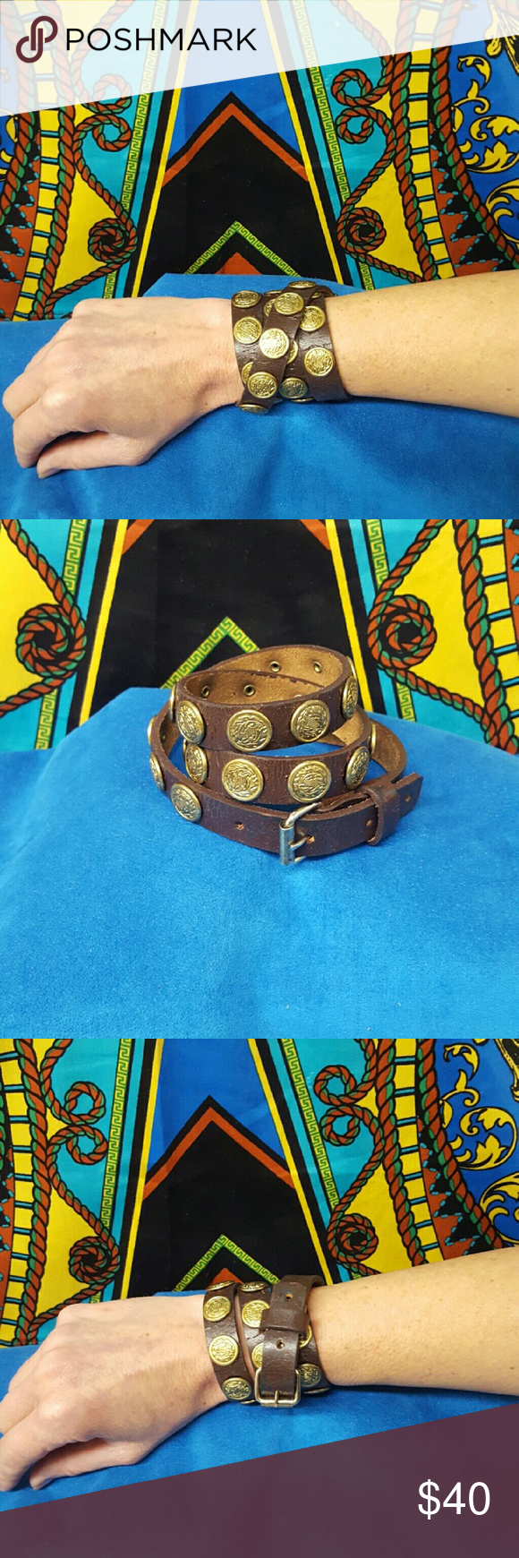 NEW ONE OF A KIND HAND MADE LEATHER WRAP CUFF NEW ONE OF A KIND DESIGN HAND MADE LEATHER WRIST WRAP CUFF. A leather wrap style braclet cuff. Vintage leather with vintage coin style embellishments. Buckle closure. Bohemian Cowgirl Collection!! Crystal's Cuffs Jewelry Bracelets