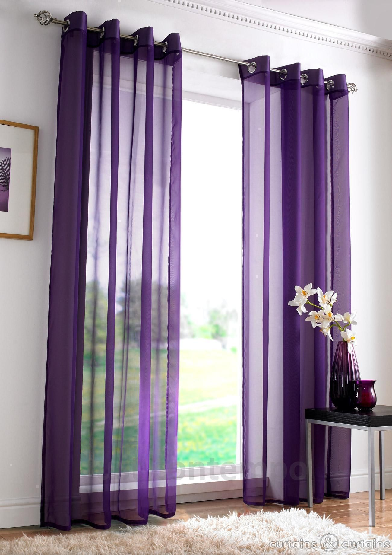 Sheer Purple Drapes Which Cover The Windows Flutter In The