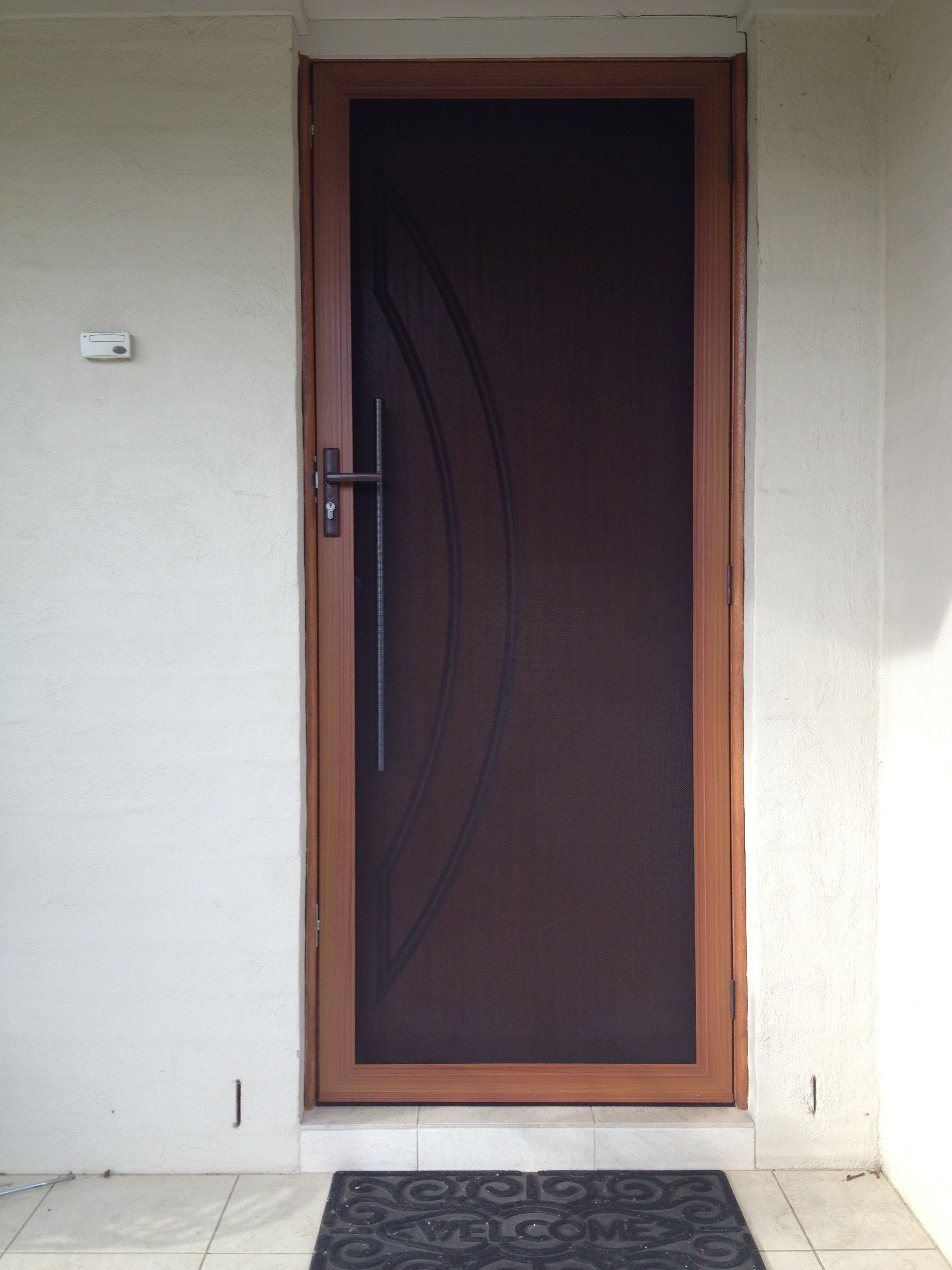 Wood Effect Hinged Security Door Effortlessly Matches Wooden Designer Front Screen