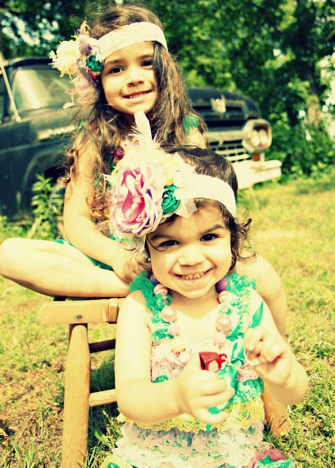 Sisters wearing their London Raquel Matching Ruffle Rompers & Headbands. Photo by Back Woods