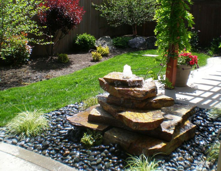 stacked stone bubbler landscape