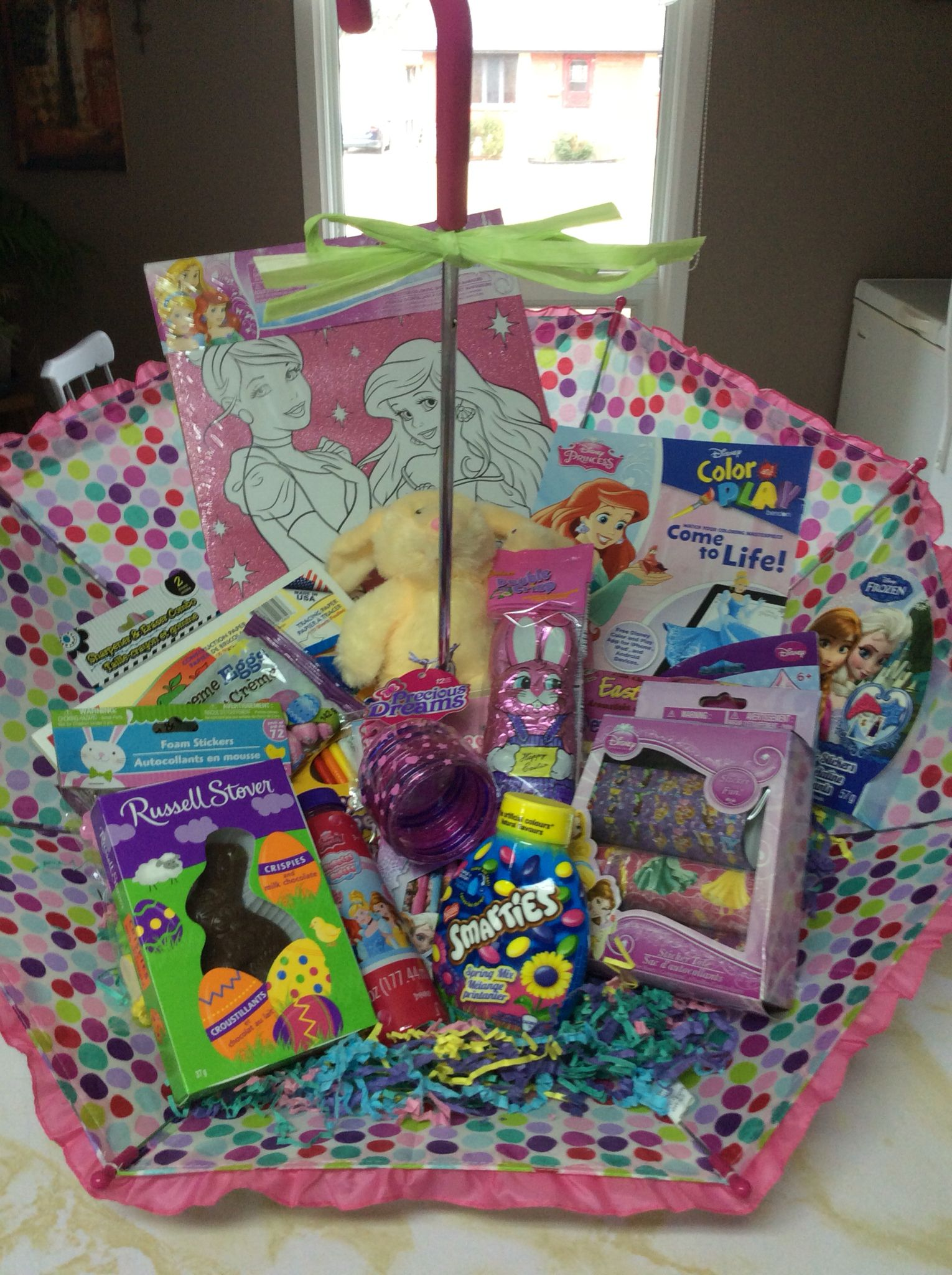 Umbrella filled with gifts and Easter treats for a little girl