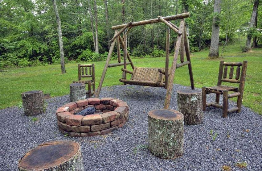 Rustic Gravel Patio With Paver Fire Pit Wood Log Benches And Wood