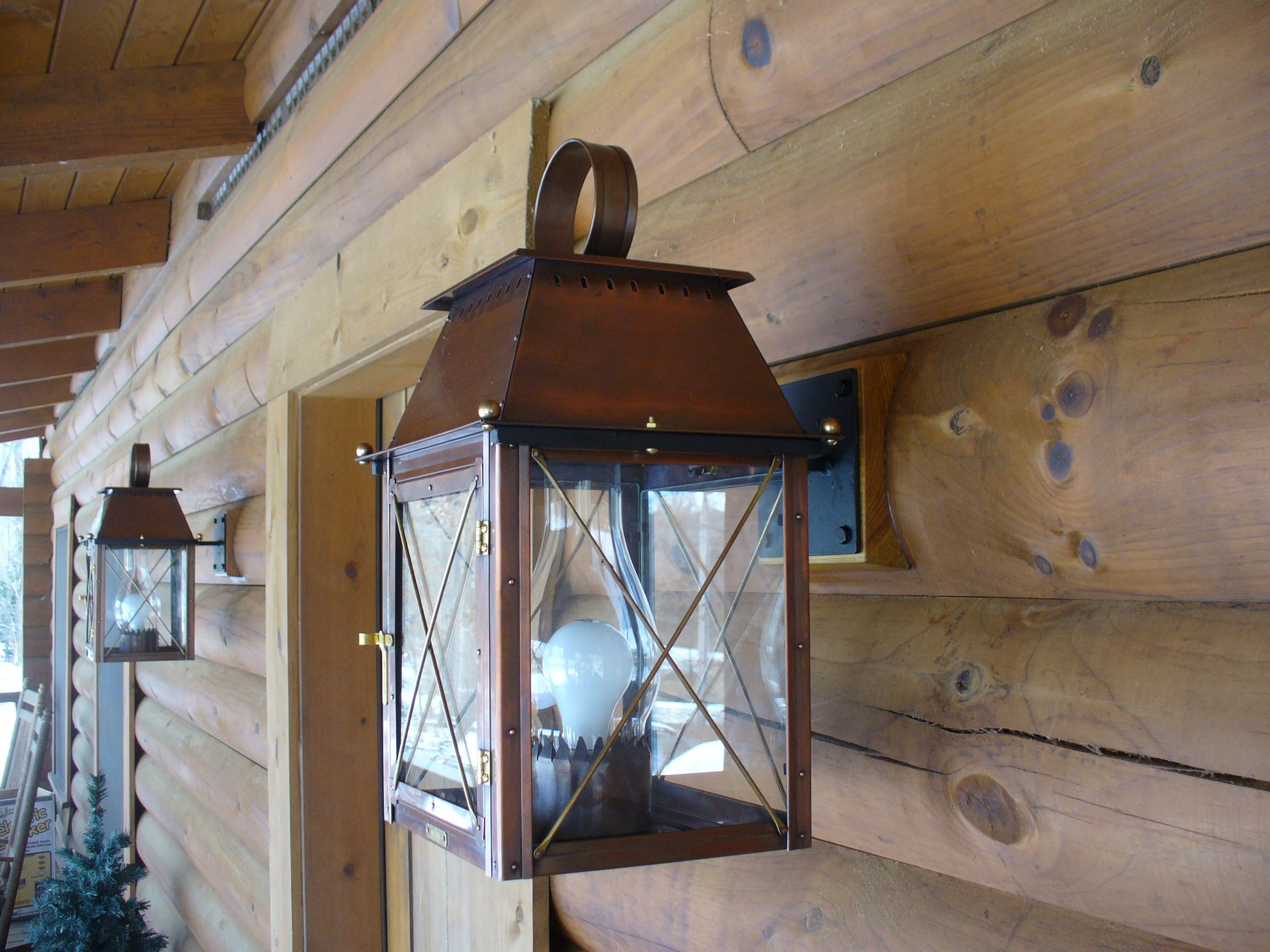 The Coach House Lantern Is Well Suited For A Rustic Log Cabin Like This One