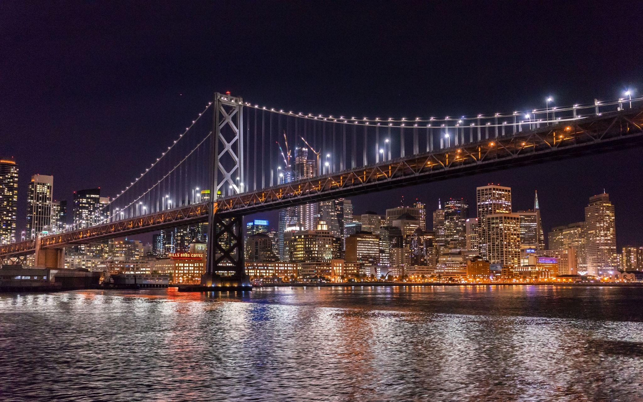 San Francisco Night Cruise View Of The San Francisco Oakland Bay Bridge And The Bright Illuminated City Of San Franc San Francisco At Night Bay Bridge Cruise