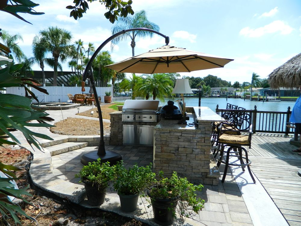 Outdoor Kitchens With Umbrella Shading Premier Outdoor Living Design Tampa Fl In 2020 Outdoor Living Design Outdoor Living Outdoor Kitchen