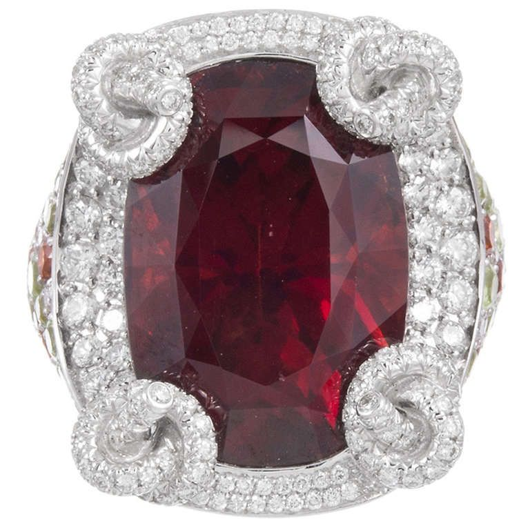 32 Carat Rhodolite Garnet Ring Signed Mauboussin | From a unique collection of vintage cocktail rings at https://www.1stdibs.com/jewelry/rings/cocktail-rings/