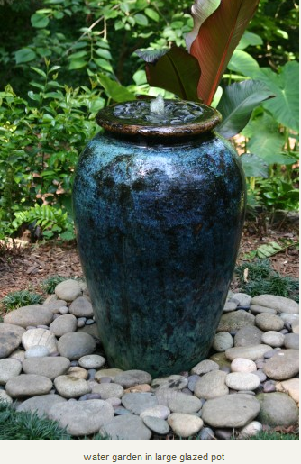 DIY Water Garden In Large Glazed Pot. Very Tranquil And The Birds Love It.  Also Adds Movement/life To A Quiet Garden.