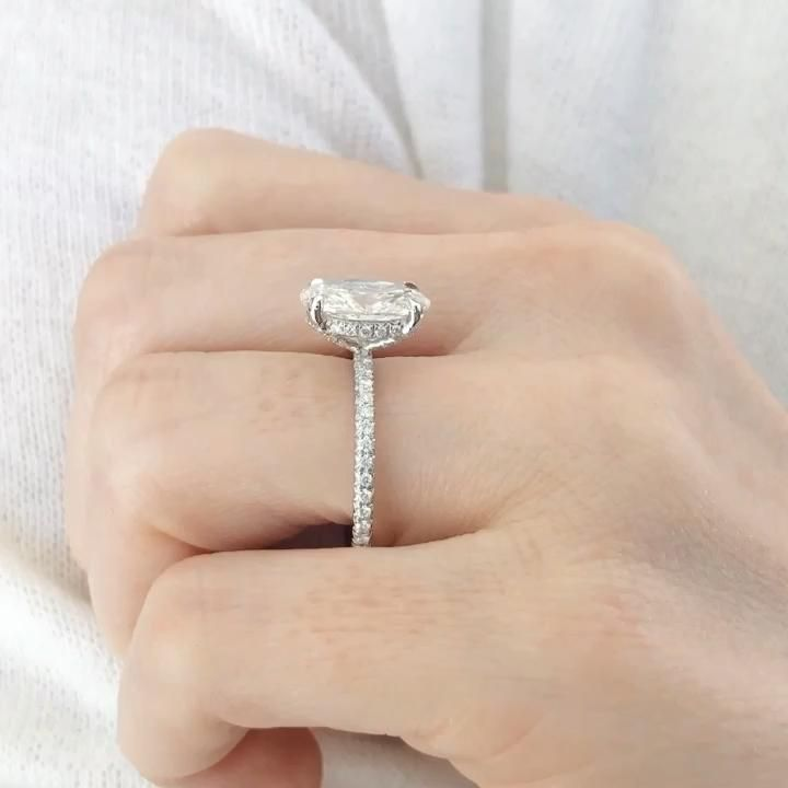 A solitaire engagement ring custom designed specially for Her. Featuring a magnificent oval cut diamond, with a delicate band and a hidden diamond halo. A timeless ring that compliments her exceptional beauty. By Ascot Diamonds.
