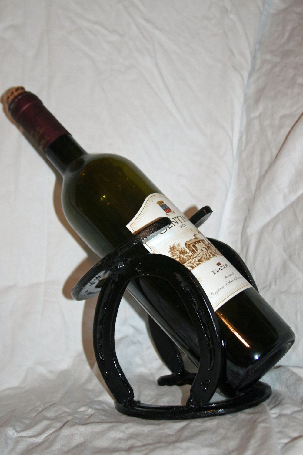 So clever horseshoe wine rack western horseshoe art for Arts and crafts wine rack