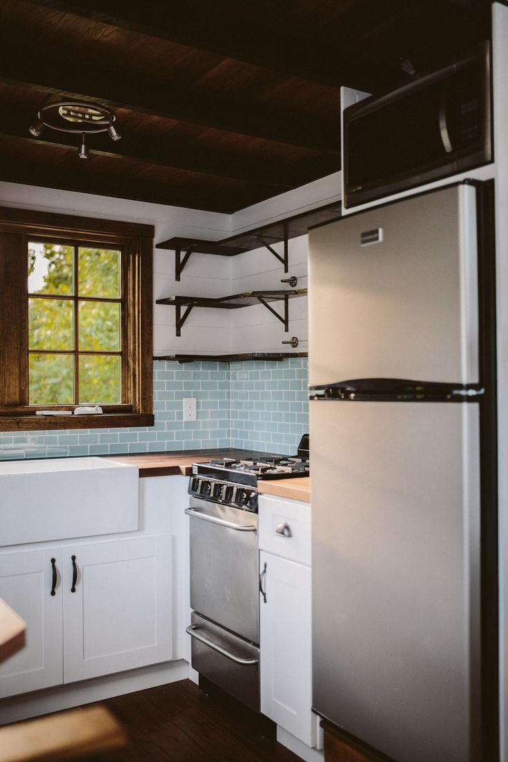 Awesome Tiny House Kitchen Includes 3/4 Refrigerator, Microwave, And Oven.  Custom
