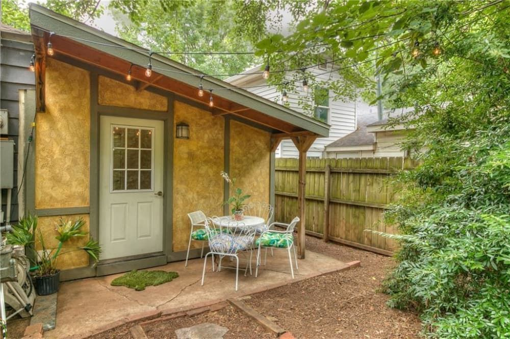 Look Inside This Enchanted Cottage For Sale In Oklahoma City Brims With Trendy Touches In 2020 Patio Cottage Backyard Fun