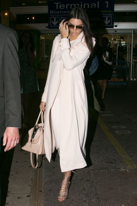 In a Camilla and Marc trench and culottes while arriving at Nice Airport in France. See all of Kendall Jenner's best looks.
