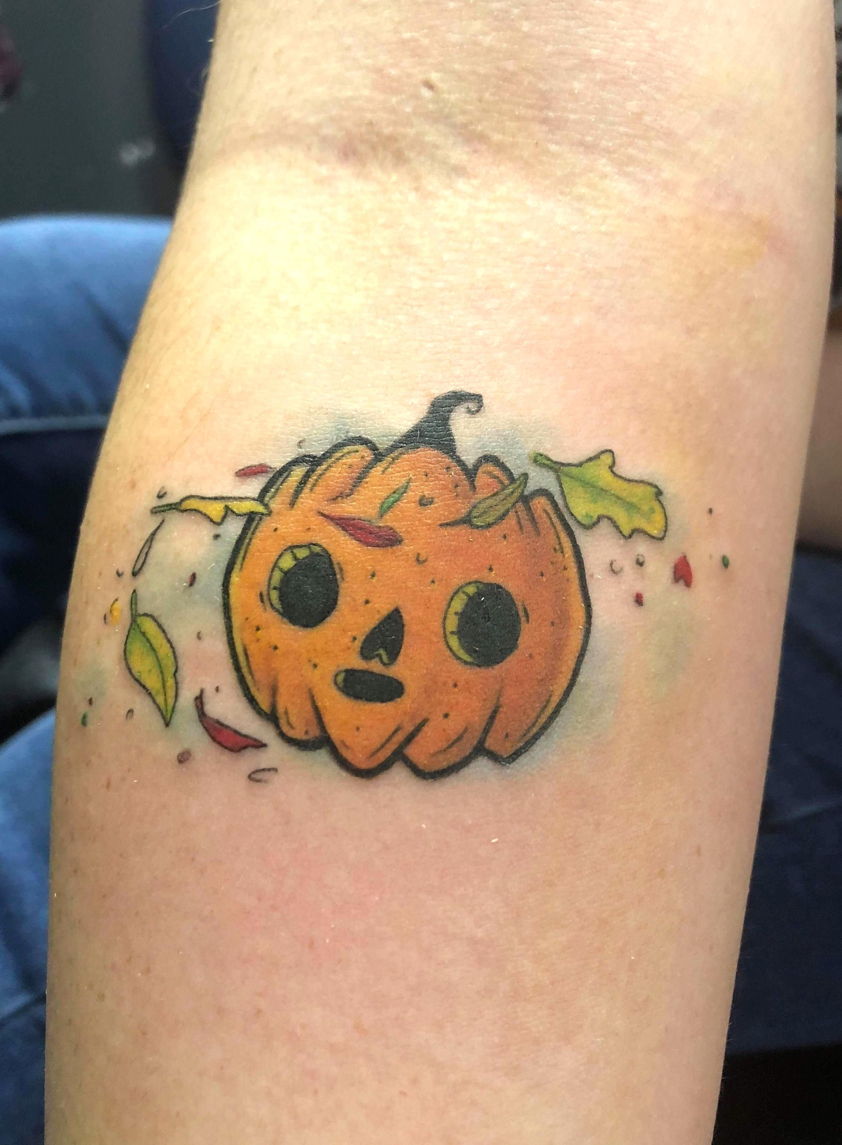 My cute pumpkin tattoo by Jerrod at Divergent Studios in Poplar Bluff MO