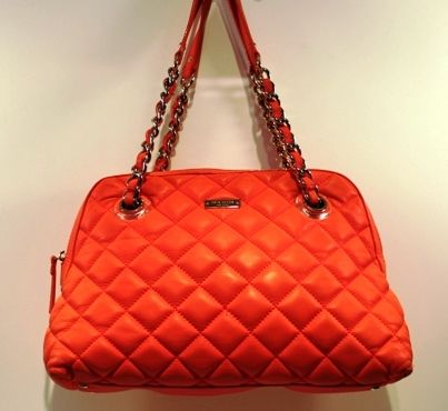 Stand out from the crowd with this gorgeous Kate Spade Orange Gold Coast Georgina Quilted Shopper Handbag. (www.handbagconsignmentshop.com)
