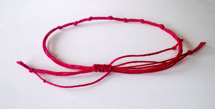 Red String Bracelet To Protect Its Owner From Danger Or