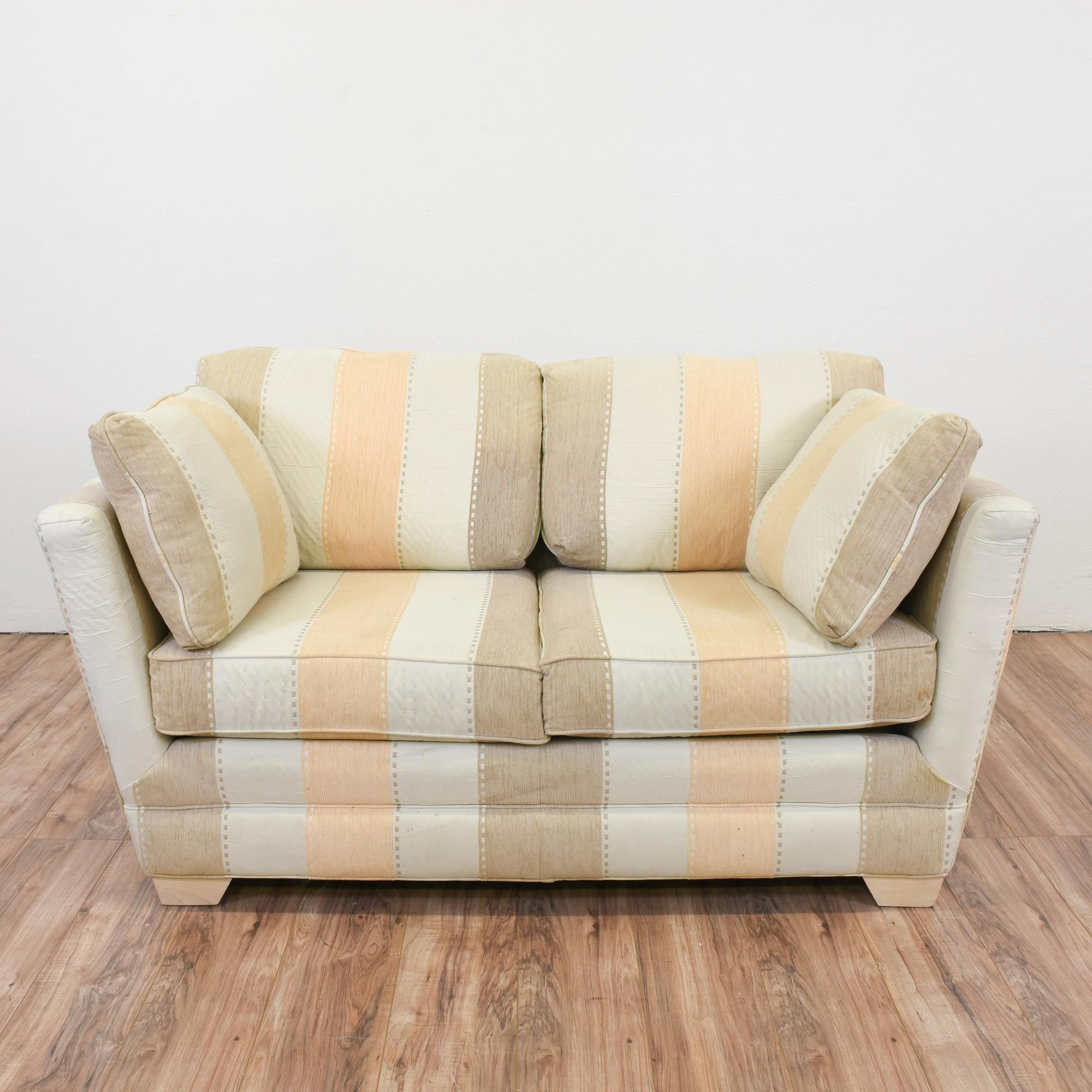 This Long Striped Loveseat Sofa Is Upholstered In Durable Fabric. The  Pattern On The Loveseat