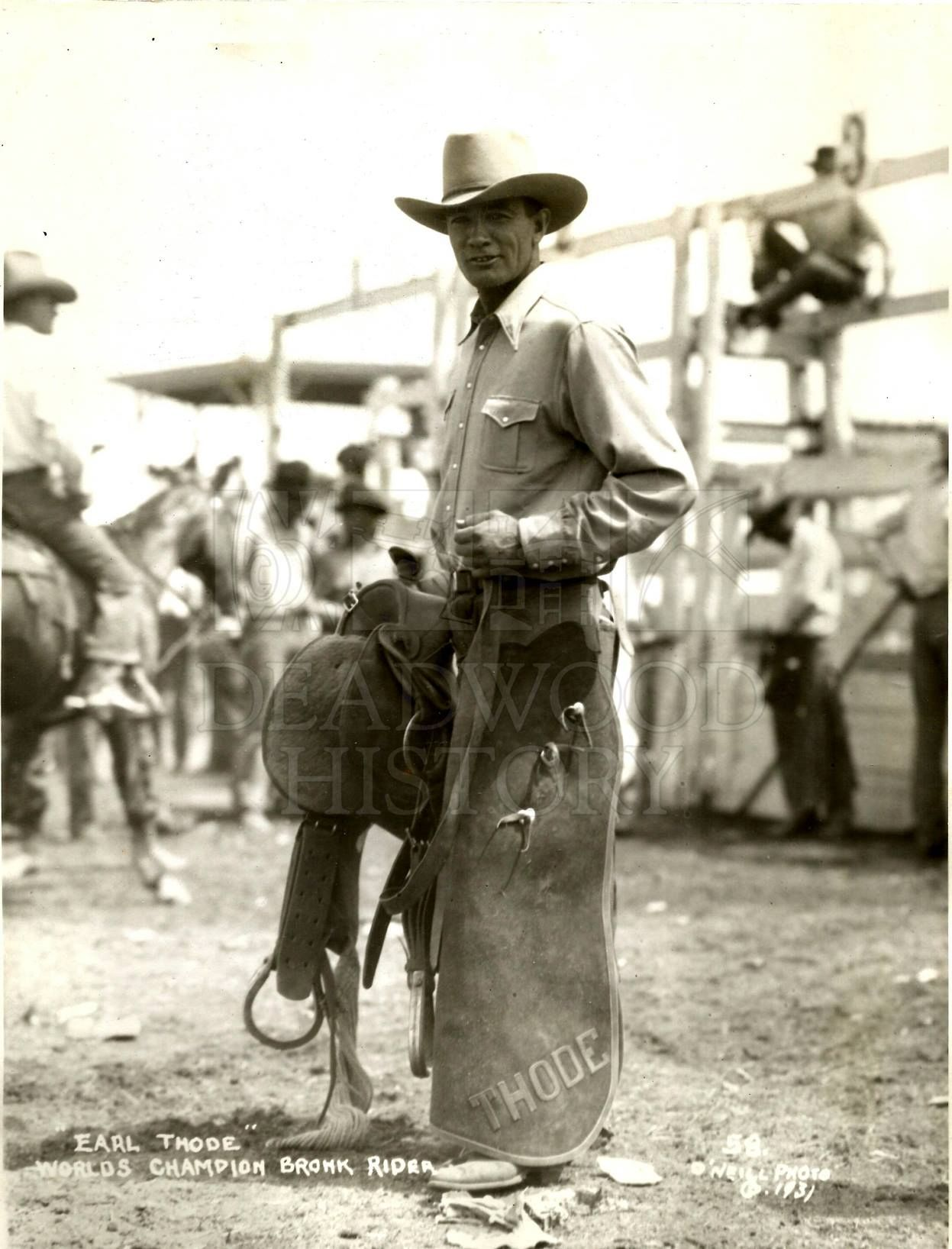 World's Champion Bronc Rider, Earl Thode, stands in his