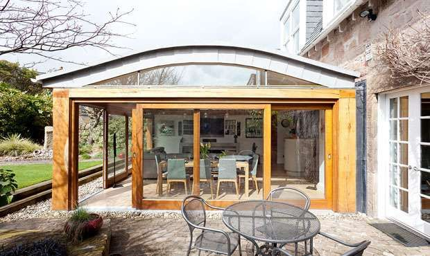 Innovative roof design An oak and glass kitchen extension ...