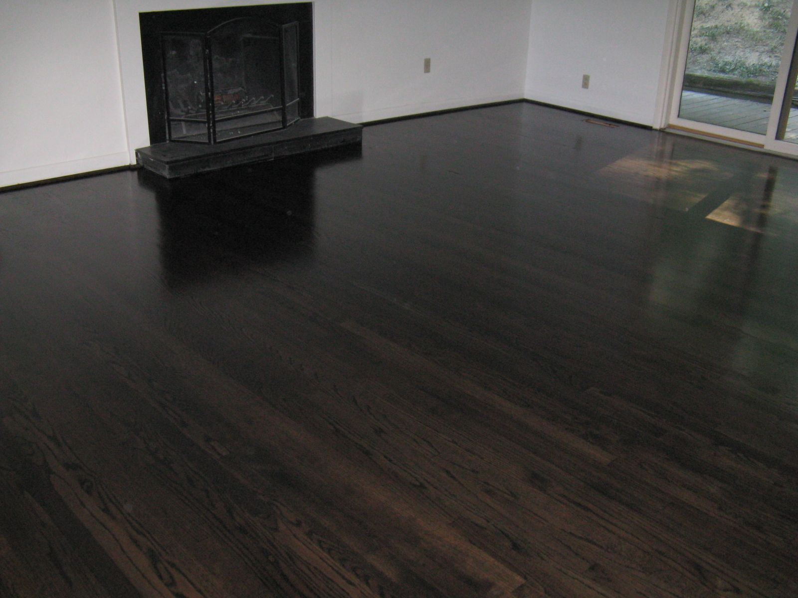 "5"" red oak stained black ebony throughout first floor"