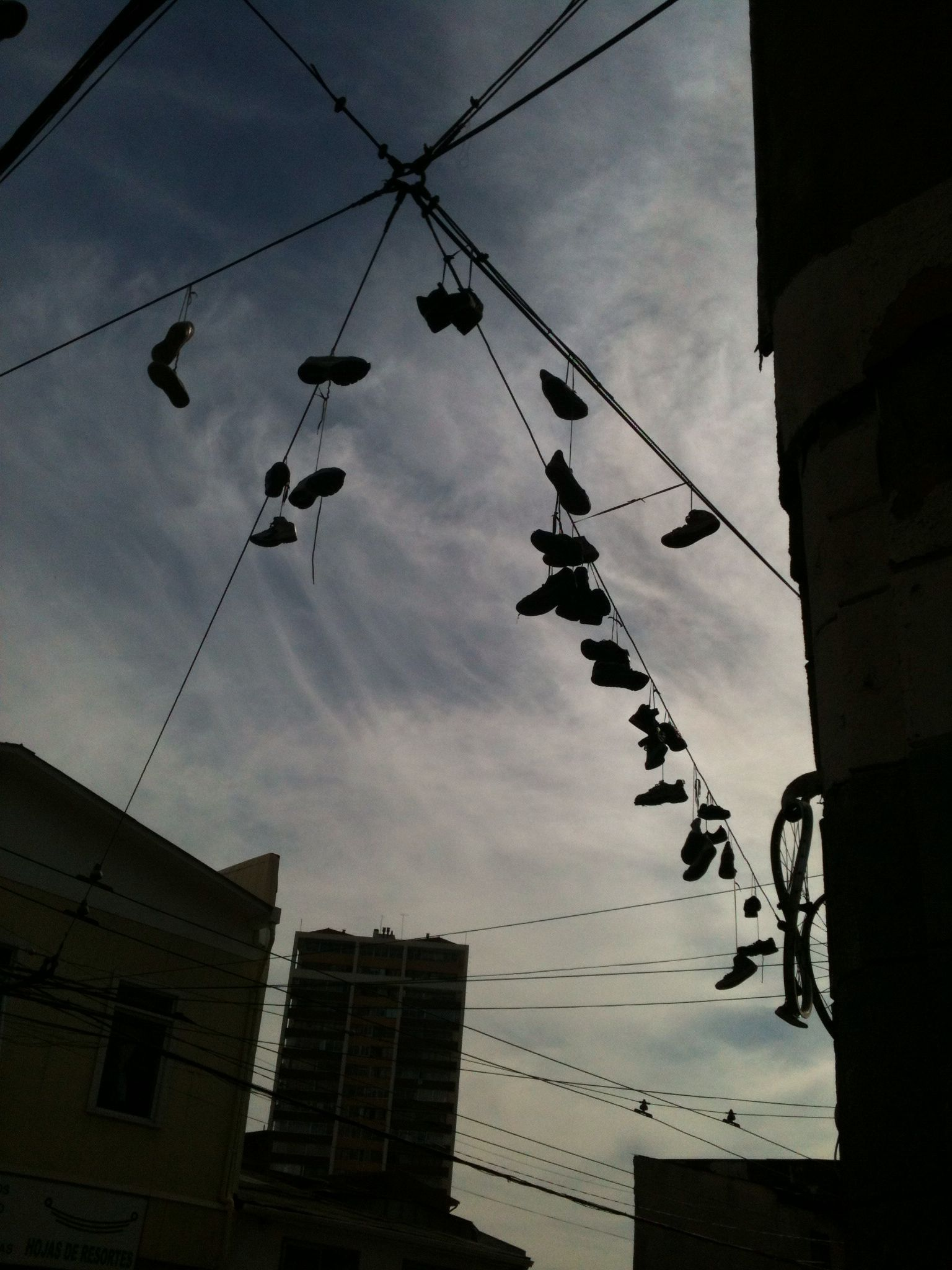 "Shoes put in electric wires out from an ""okupa""-house, in Valparaíso town"