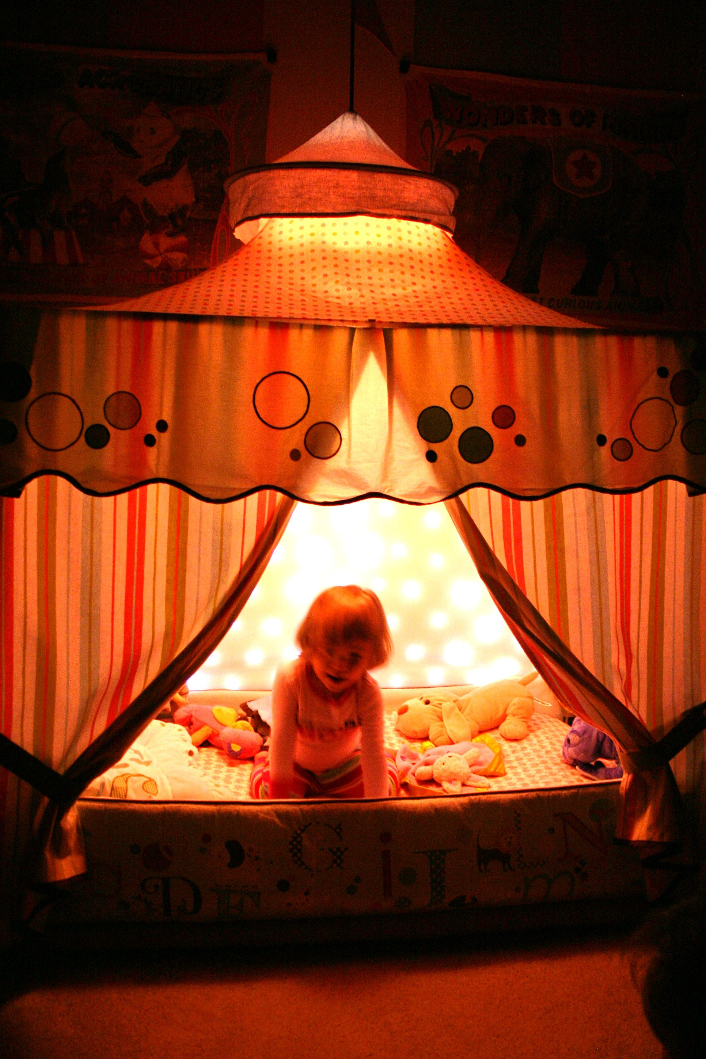 Circus tent bed canopy with light curtain inside. Little