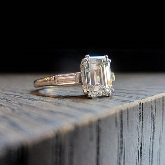 Vintage emerald cut diamond engagement ring with baguettes, from Doyle &  Doyle.