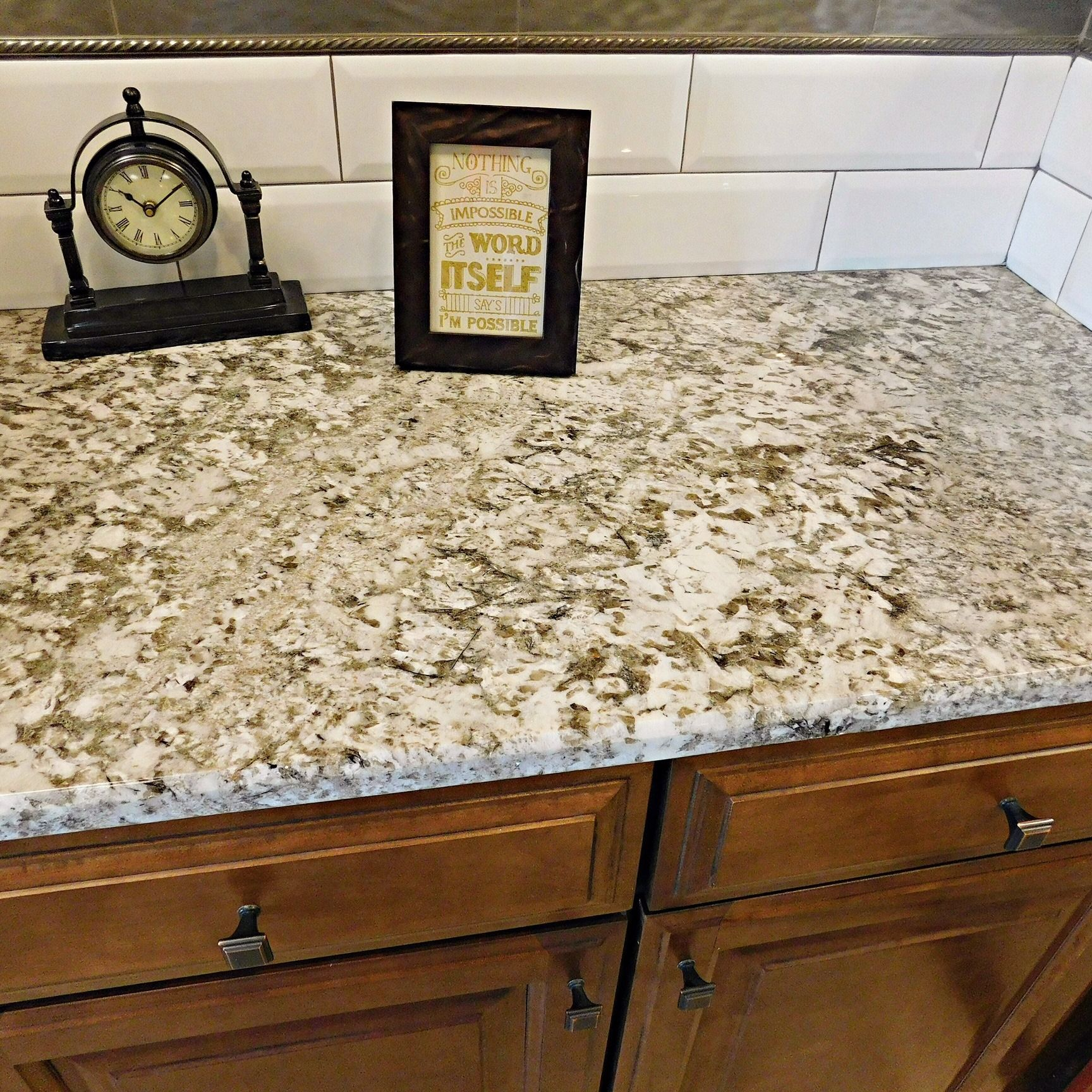 Two Of Our Most Popular Countertops - Fantasy Brown Satin Marble (https://