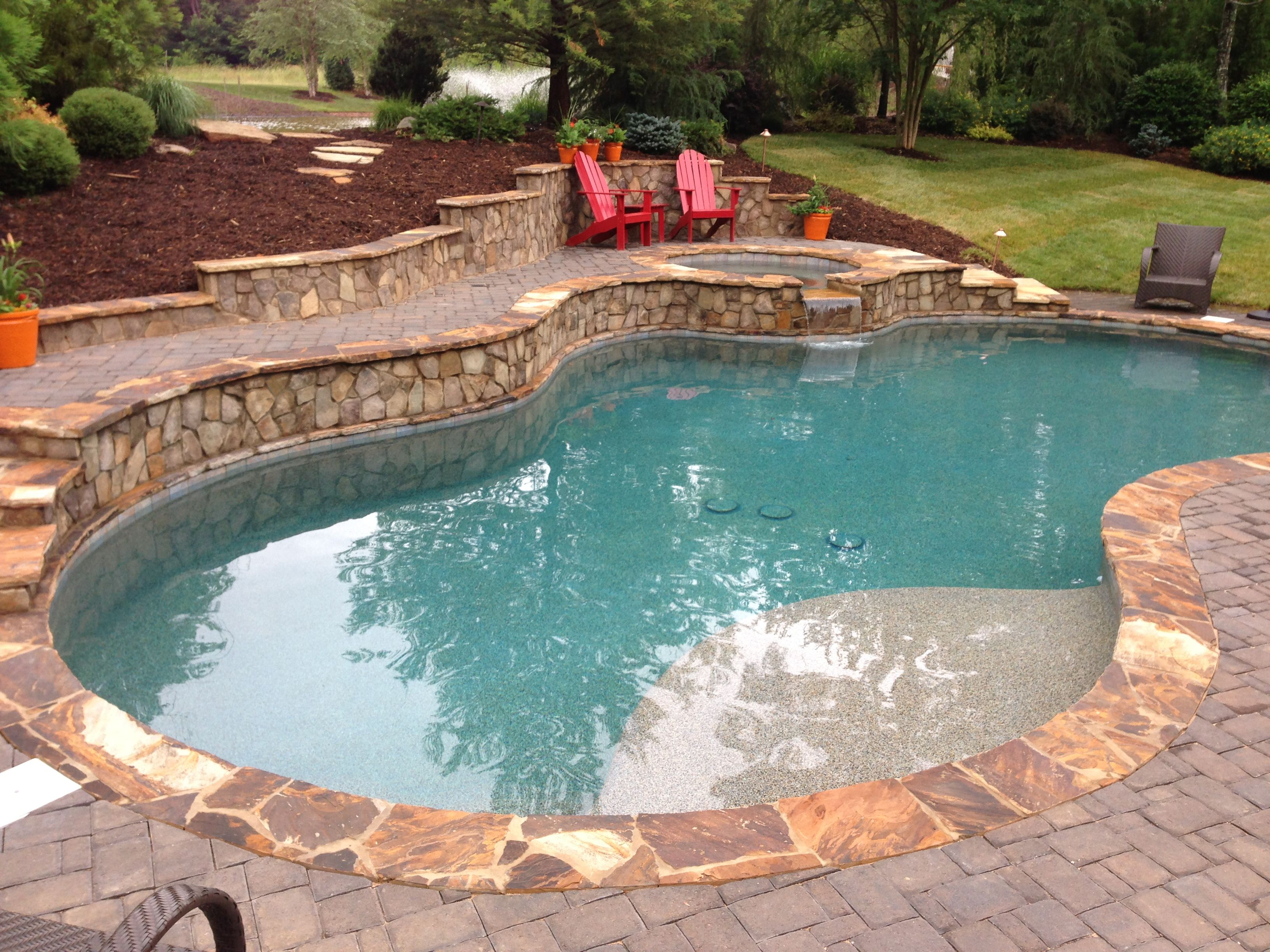Challenging Yard Due To Elevation Makes For A Beautiful Swimming Pool And Spa Artisan Pools And Spas Building A Pool Pool Pool Houses