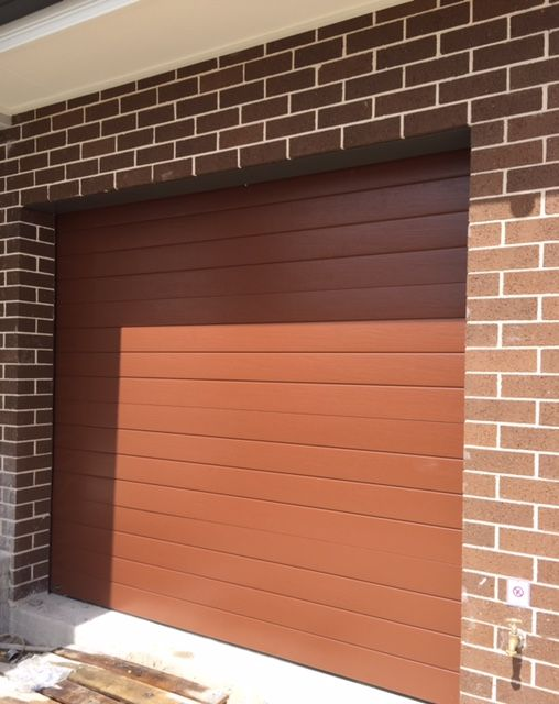 Garage door painted in terrain by colourbond outside the for Garage door colors