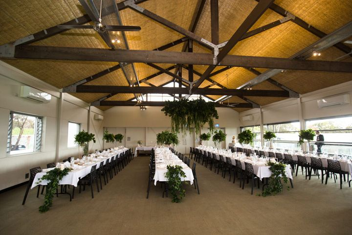 Wedding reception decor + greenery chandelier hung from ceiling | itakeyou.co.uk #weddingreception #greenerychandelier