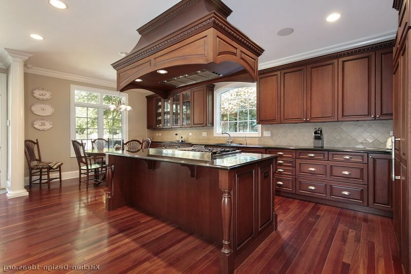 Image result for kitchens with cherry cabinets and black ...