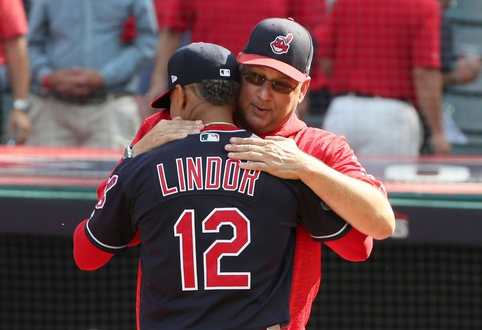 Cleveland Indians Francisco Lindor hugs manager Terry