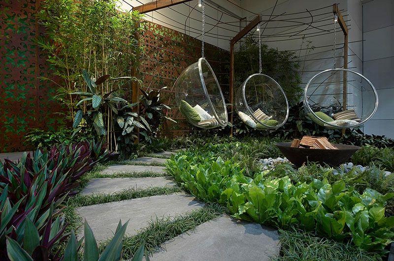 Appealing Buble Swing Chairs In Tropical Green Garden Landscape